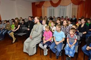 priest with children